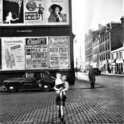 Check the ads, lads! (Howard Street at Stockwell Street, October 17, 1953, by Haywood Magee)