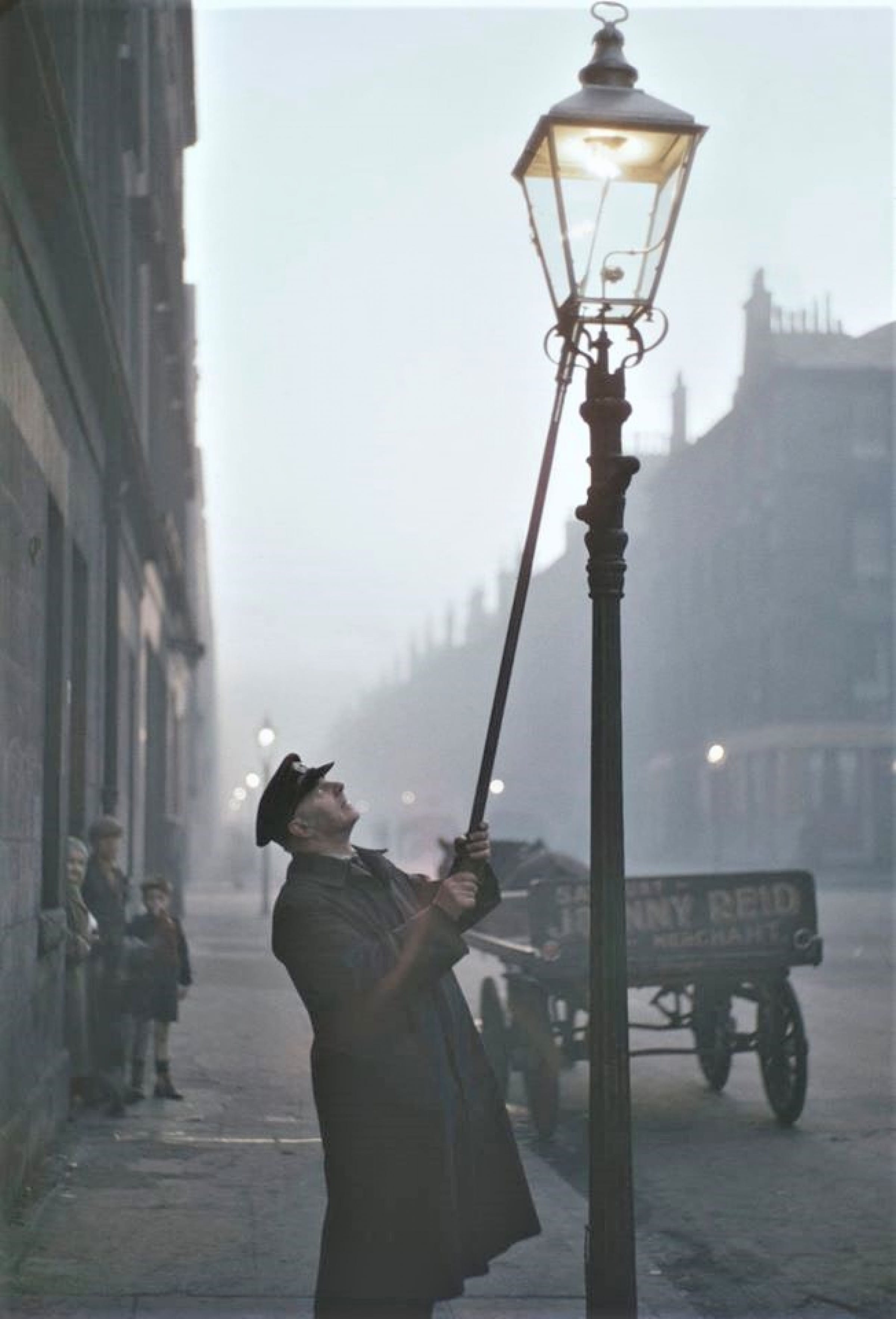 Strike a light (A 'Leerie' lights a street gas lamp, 1955 (Picture Post))