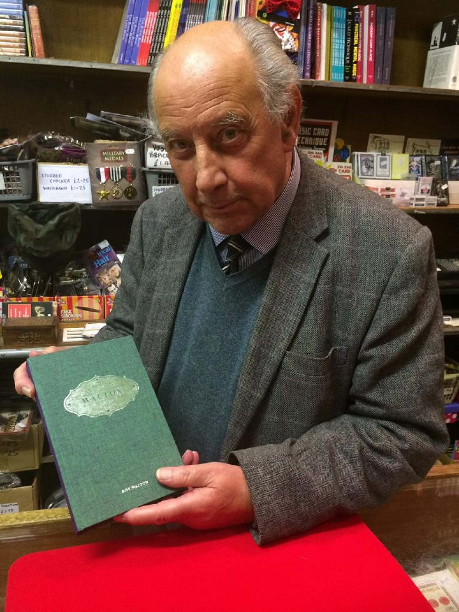 Roy Walton RIP, with one of his magic books.
