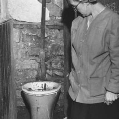 A tale of two cludgies... (Communal, stairheed lavvy, Gorbals 1948 (Picture: Mark Kauffman))