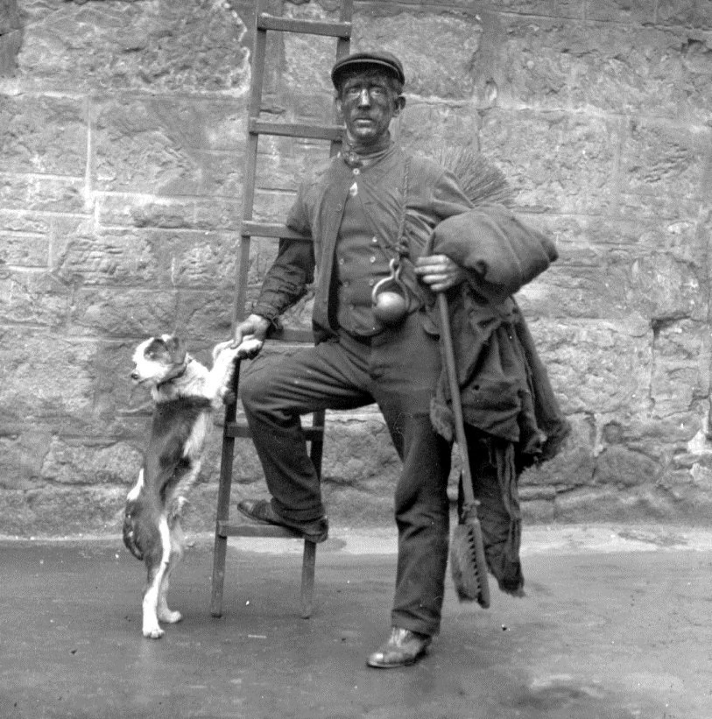 Sooty and sweep (Glasgow chimney sweep and his dog, circa 1920 (Glasgow City Archives))