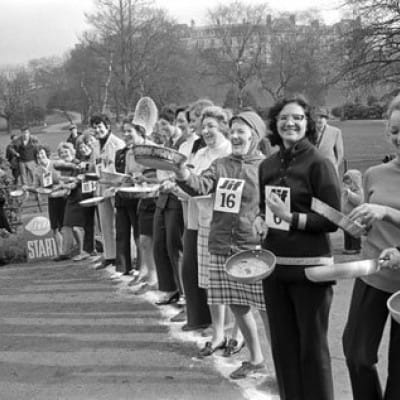 Top tossers race for the line (Ready for the off! Glasgow's pancake racers in Kelvingrove Park, in 1971 (TSPL))