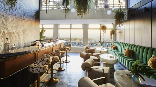 The bar in the penthouse Centre Point Residences