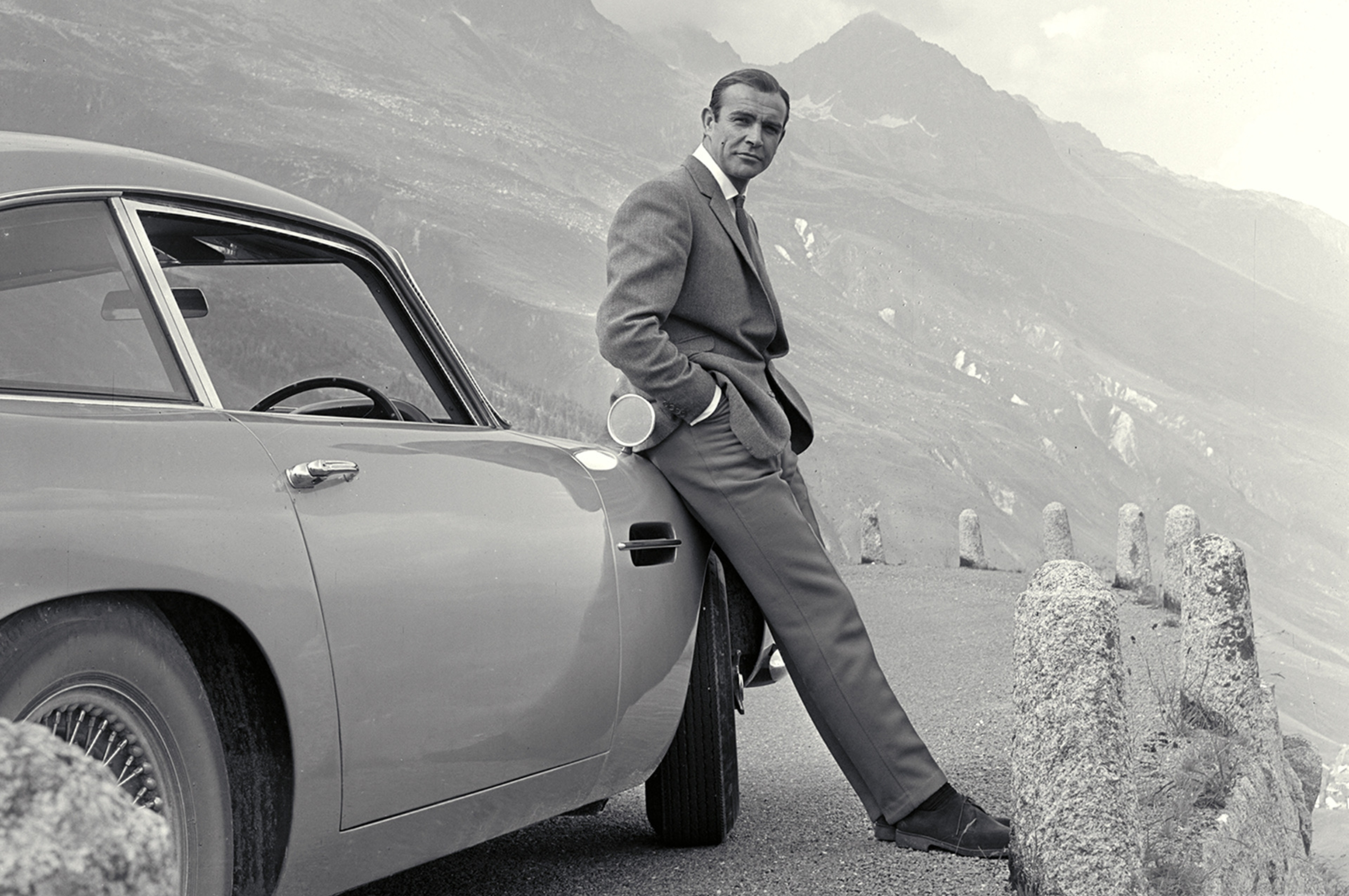 "Sean Connery with the Aston Martin DB5 in the Swiss Alps ""Goldfinger"" 1964"
