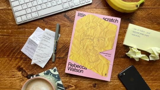 Little Scratch by Rebecca Watson on a desk with a banana, post-it notes and and iphone