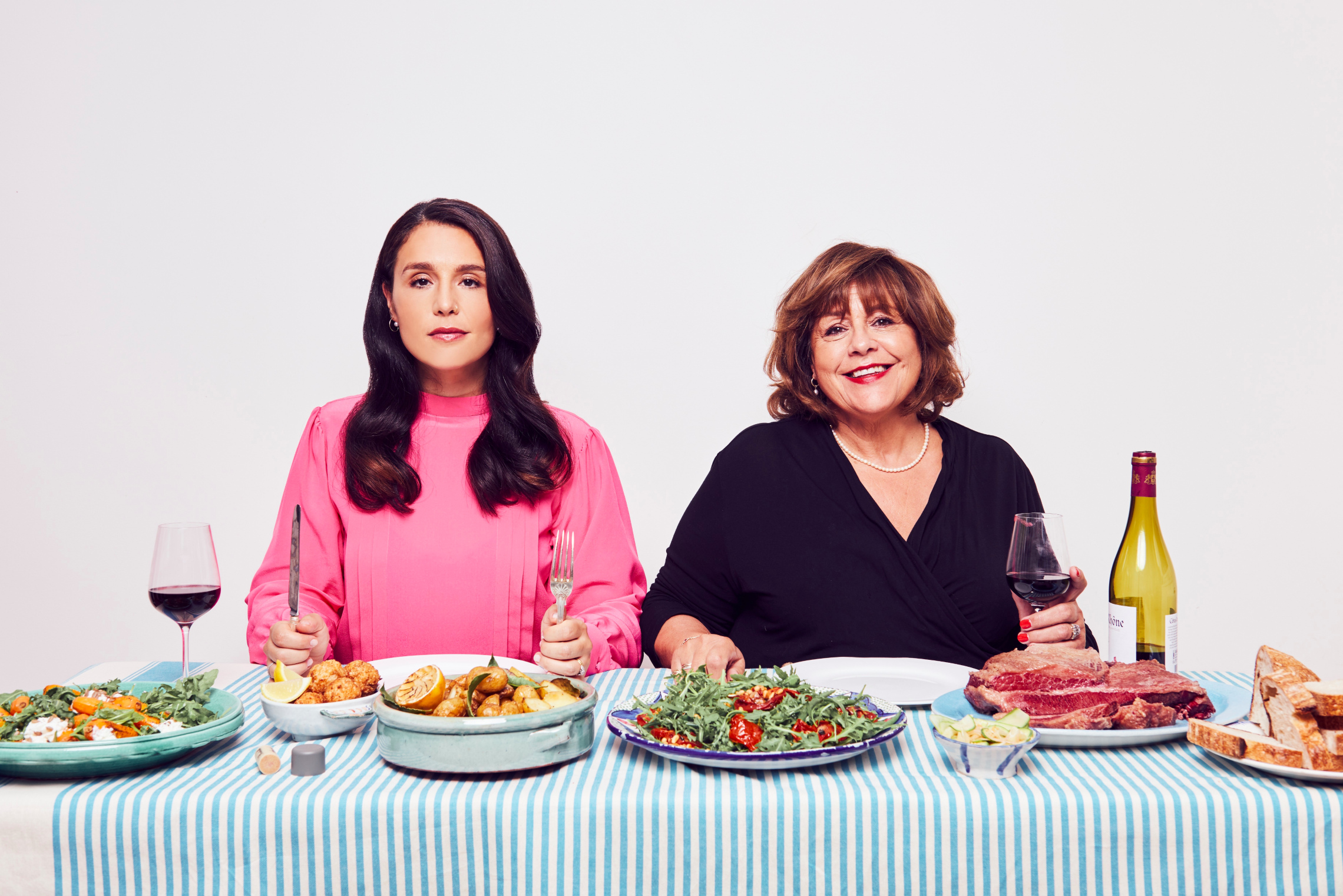 Jessie Ware and Lennie Ware sitting at a table with lots of food