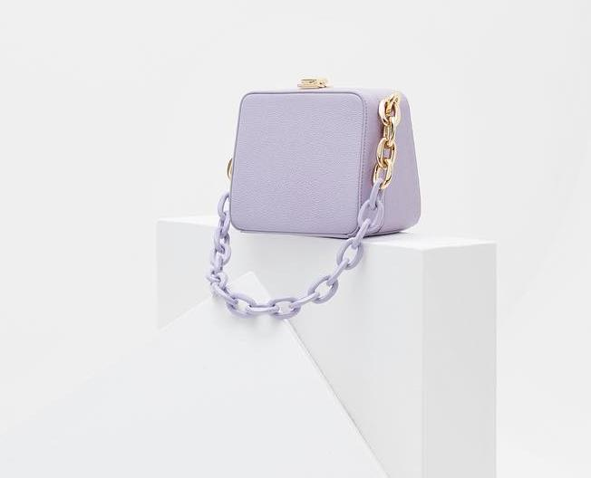 187a487a8d ... pastel-hued leather with and a chunky chain shoulder strap