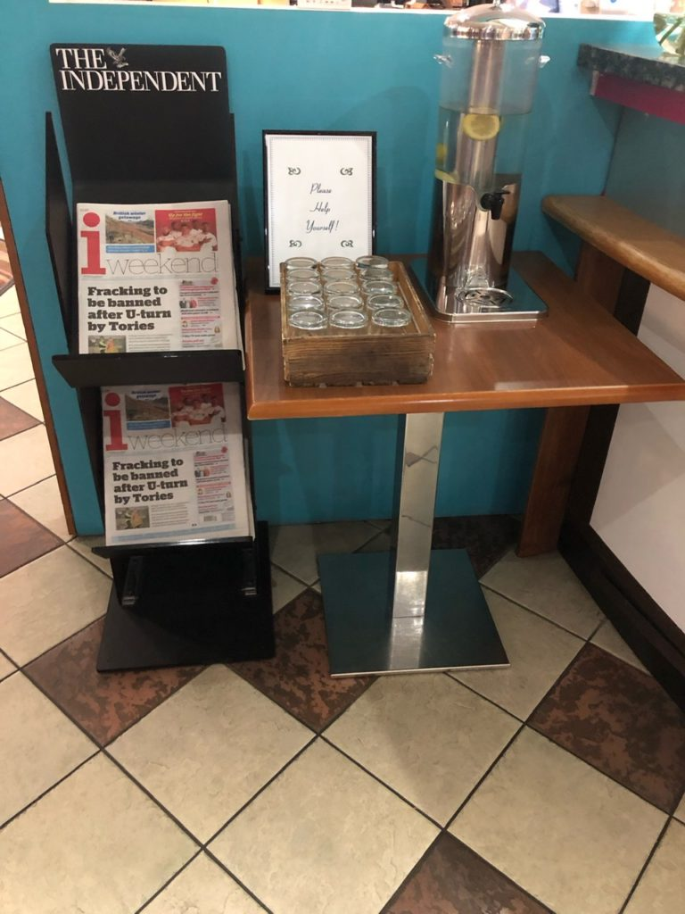Water and newspapers at Holiday Inn Express Poole
