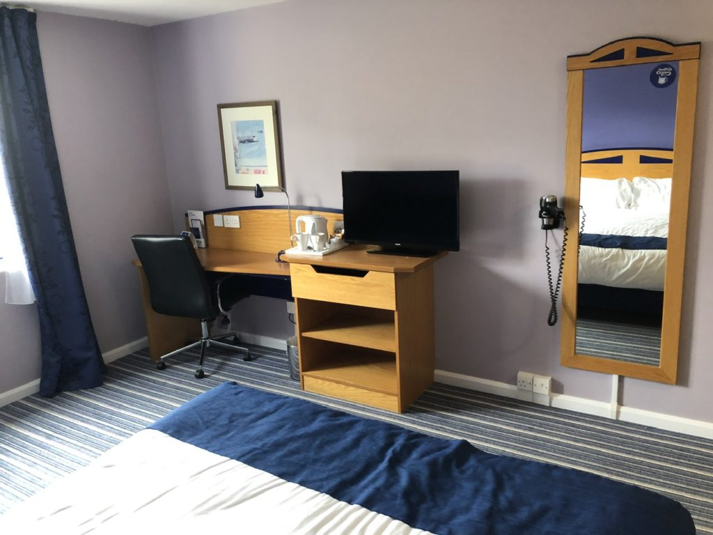 Desk and TV at Holiday In Express Poole