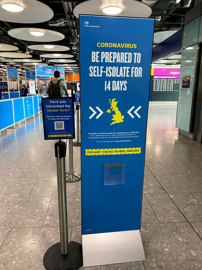 Heathrow Airport self-isolate sign