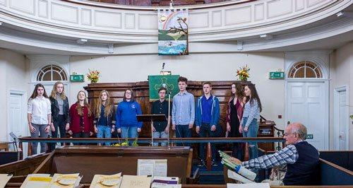 Youth Choir members rehearsing with John Rutter