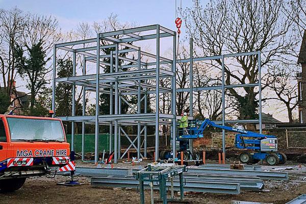Steel frame construction begins on site.