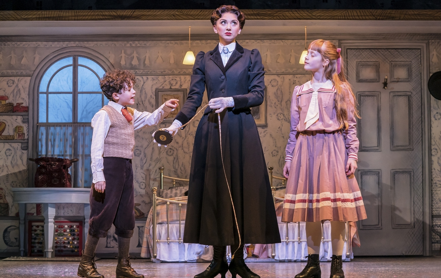 Zizi Strallen as Mary Poppins and Children- Photograph Johan Persson