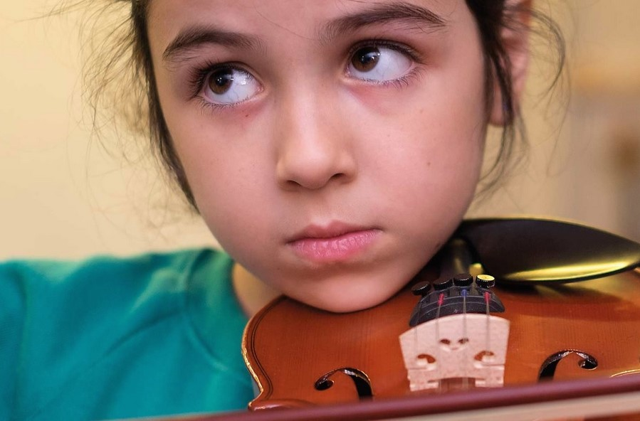 Fifty New Violins for Walnut Tree Walk Primary School