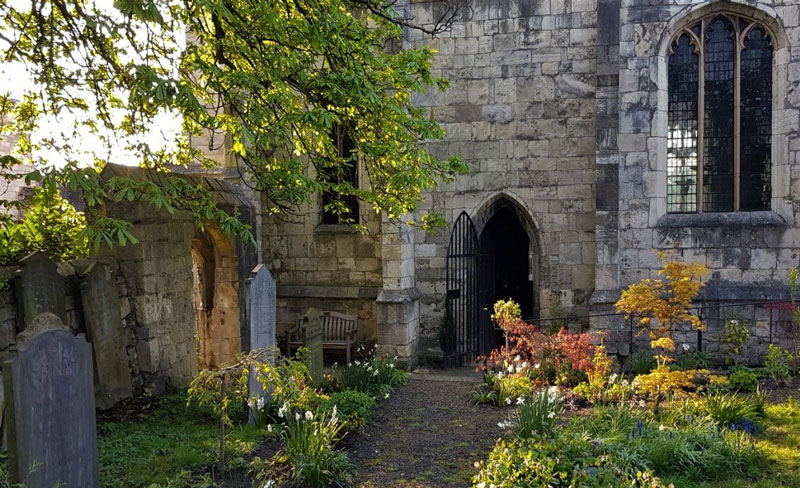 The south door of St Olave's from the churchyard