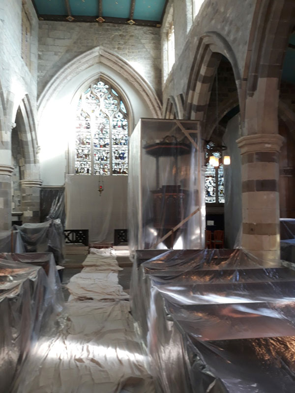 The pulpit and pews enclosed in plastic