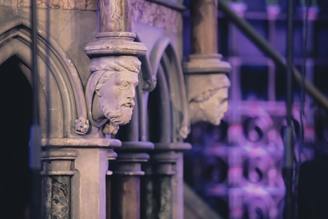 Images of the Reformers carved into the Pulpit.