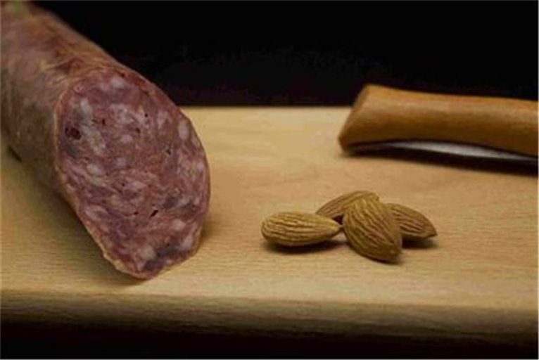 Cured sausage with almonds