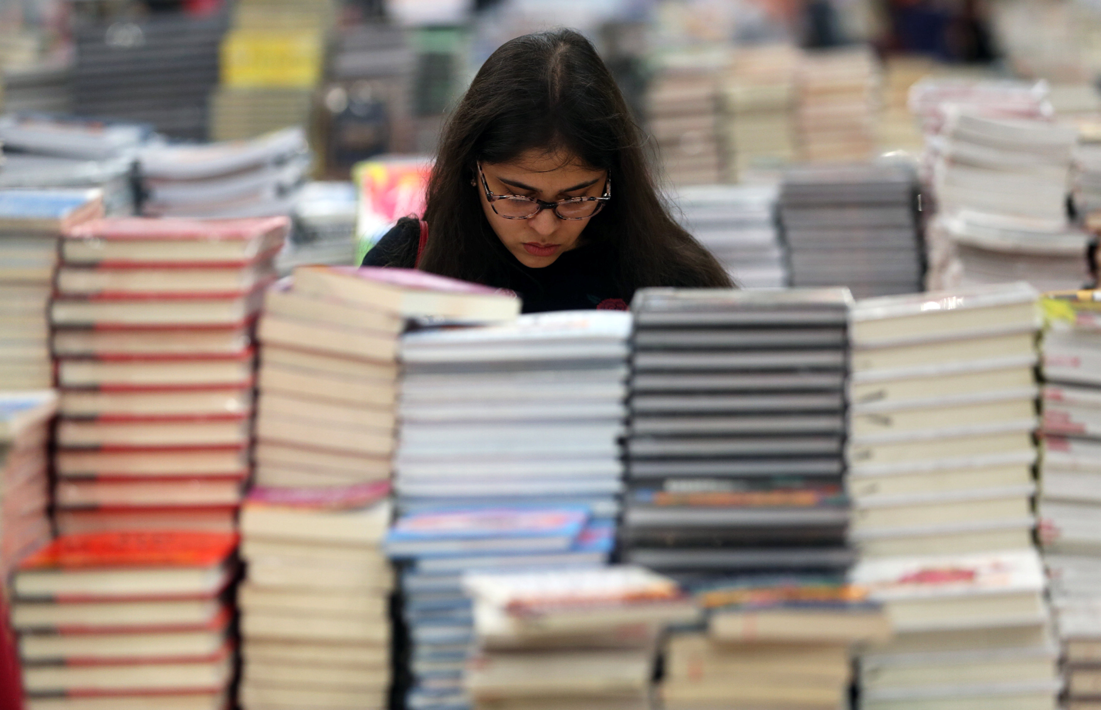 A visitor reads a book at the Big Bad Wolf Book Sale.