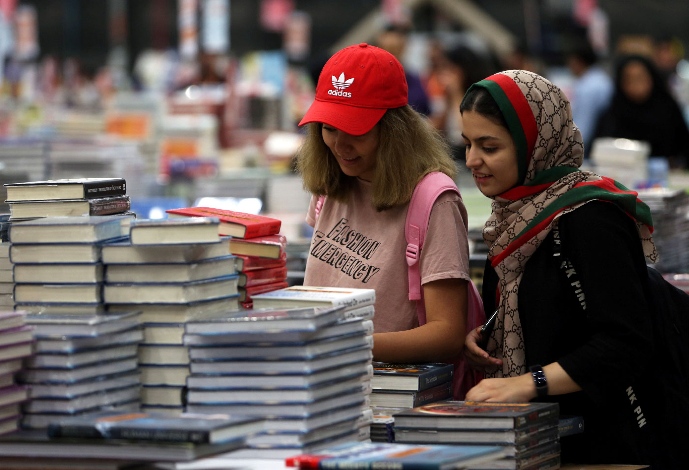 Visitors read books at the Big Bad Wolf Book Sale.