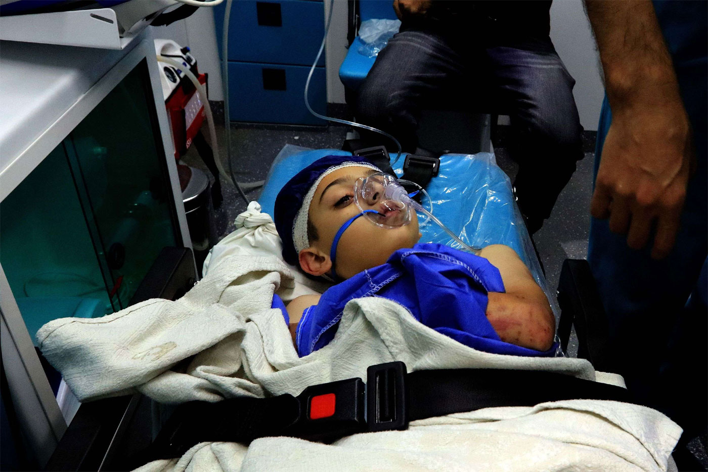 A wounded pupil lays on a stretcher at a hospital after a bus accident near the Dead Sea in Jordan