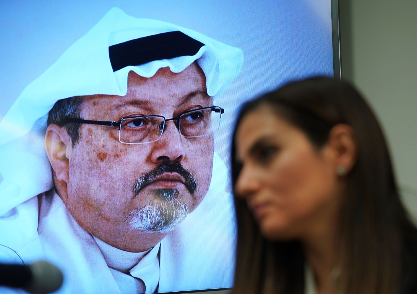 Sherine Tadros, head of New York (UN) Office of Amnesty International, speaks in front of a picture of Jamal Khashoggi during a news conference at the United Nations.