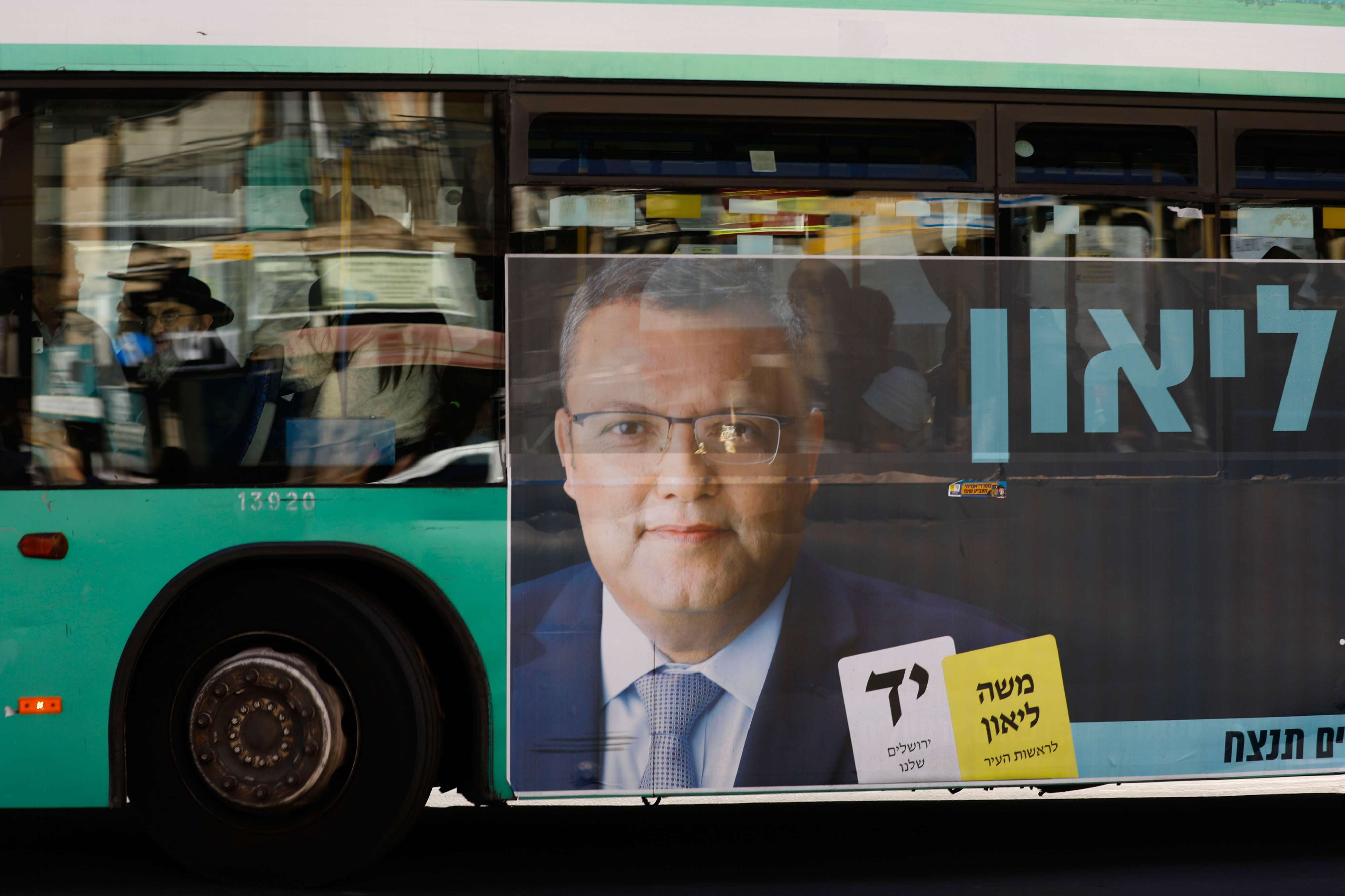 A campaign poster of municipal candidate Moshe Lion on a bus ahead of the upcoming Jerusalem municipal elections, in Jerusalem.
