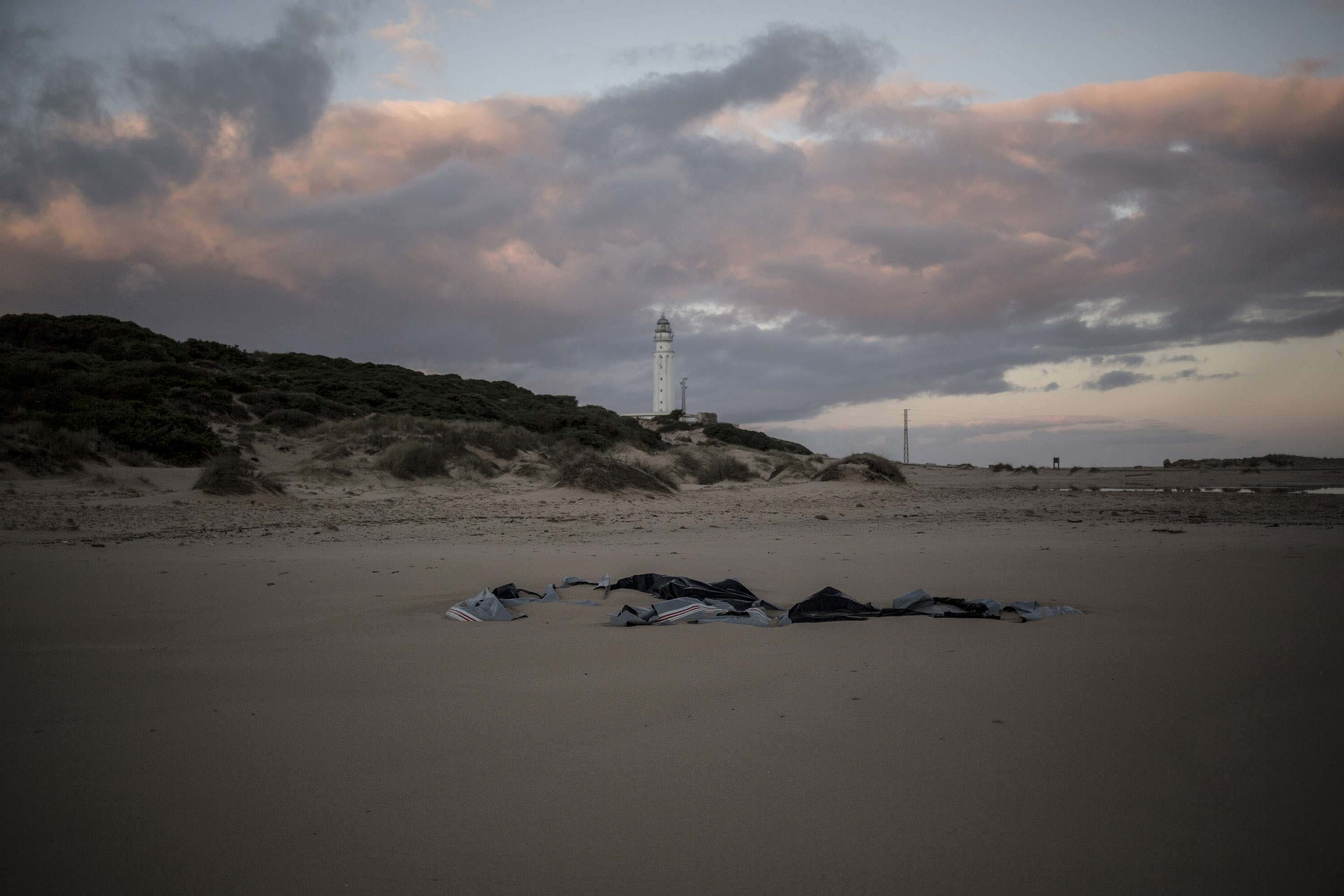 Remains of a dinghy lies on the beach near the village of Canos de Meca in southern Spain, Tuesday, Nov. 6 2018