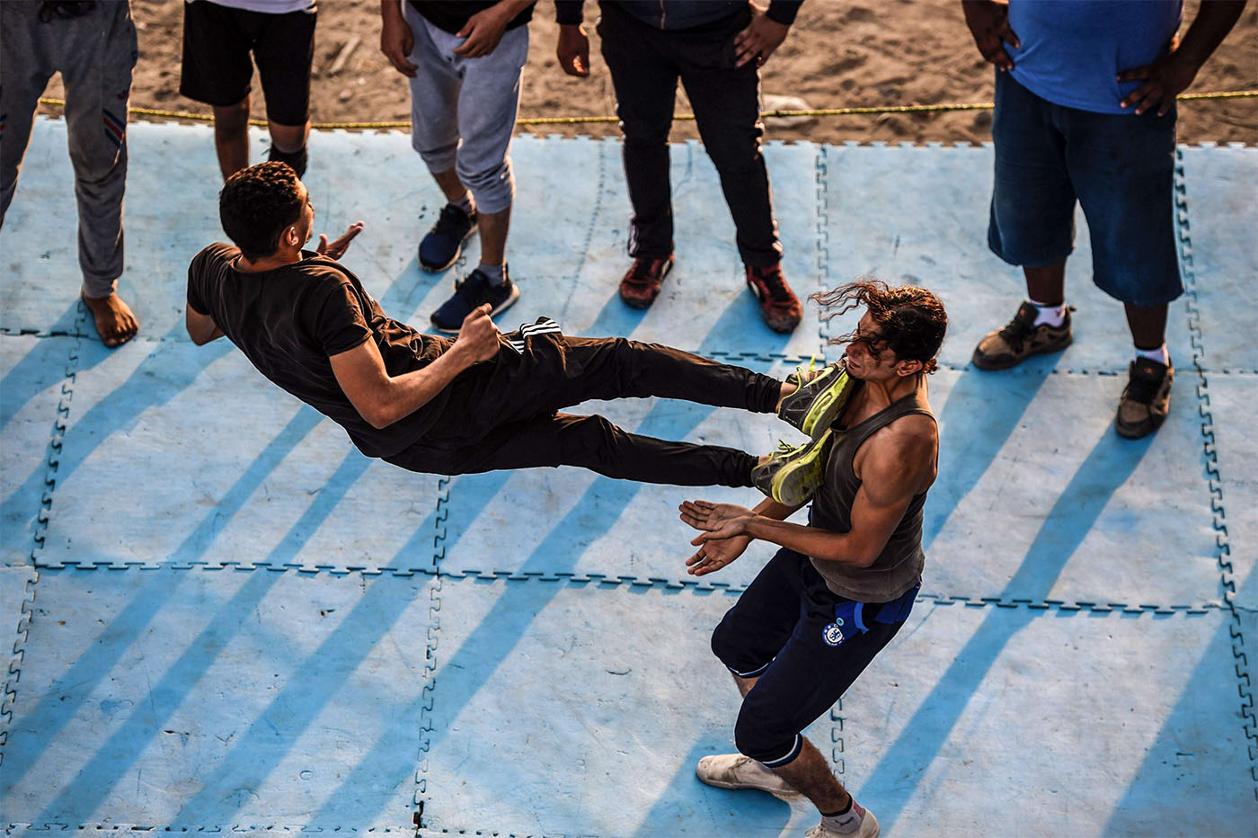 Members of the self-declared Egyptian Wrestling Federation (EWR) train in a ring during a session in the village of Serapeum