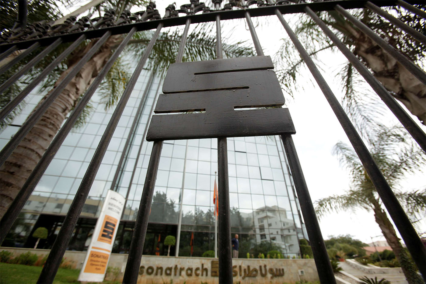 The logo of the state energy company Sonatrach is pictured on a gate outside the headquarters in Algiers