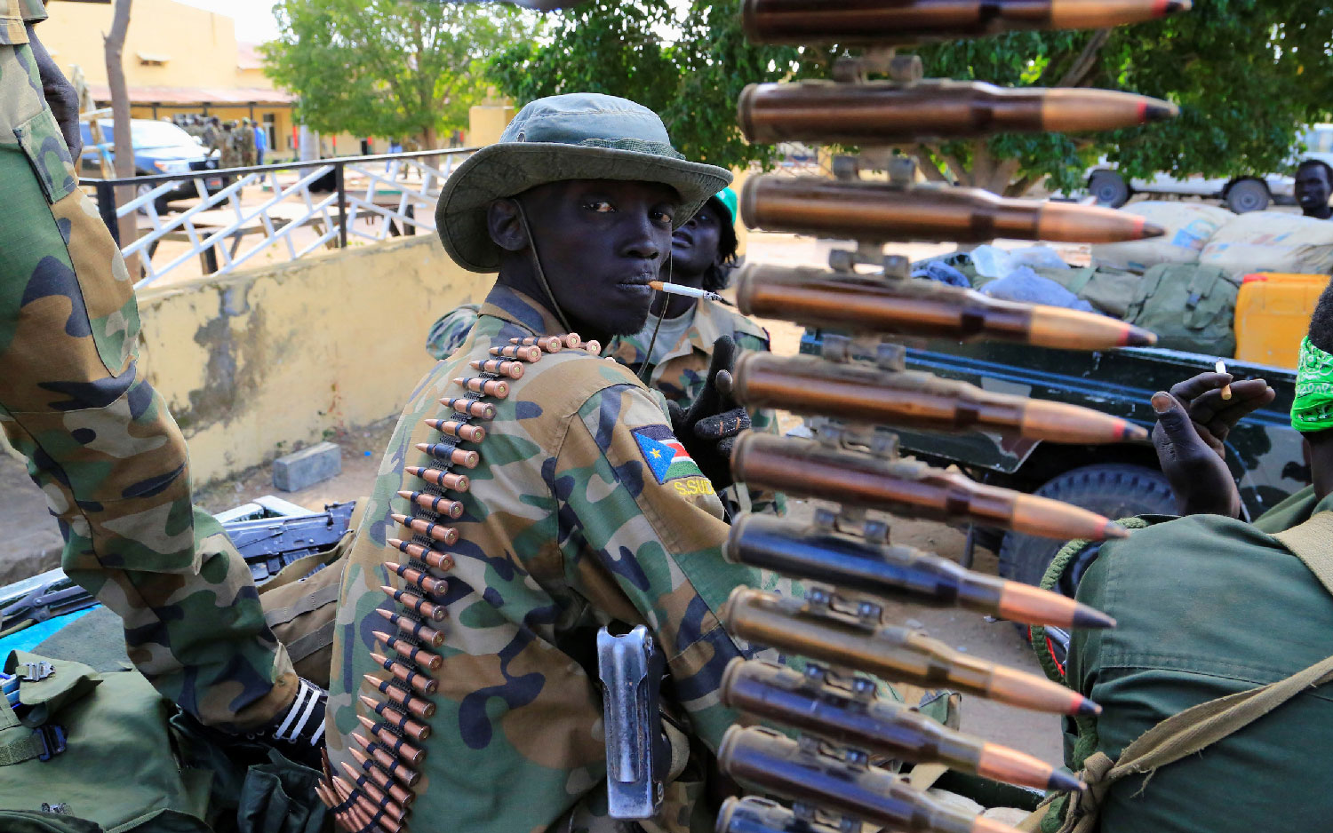 A South Sudanese soldier stands next to a machine gun mounted on a truck in Malakal town, northeast of Juba, South Sudan December 30, 2013.