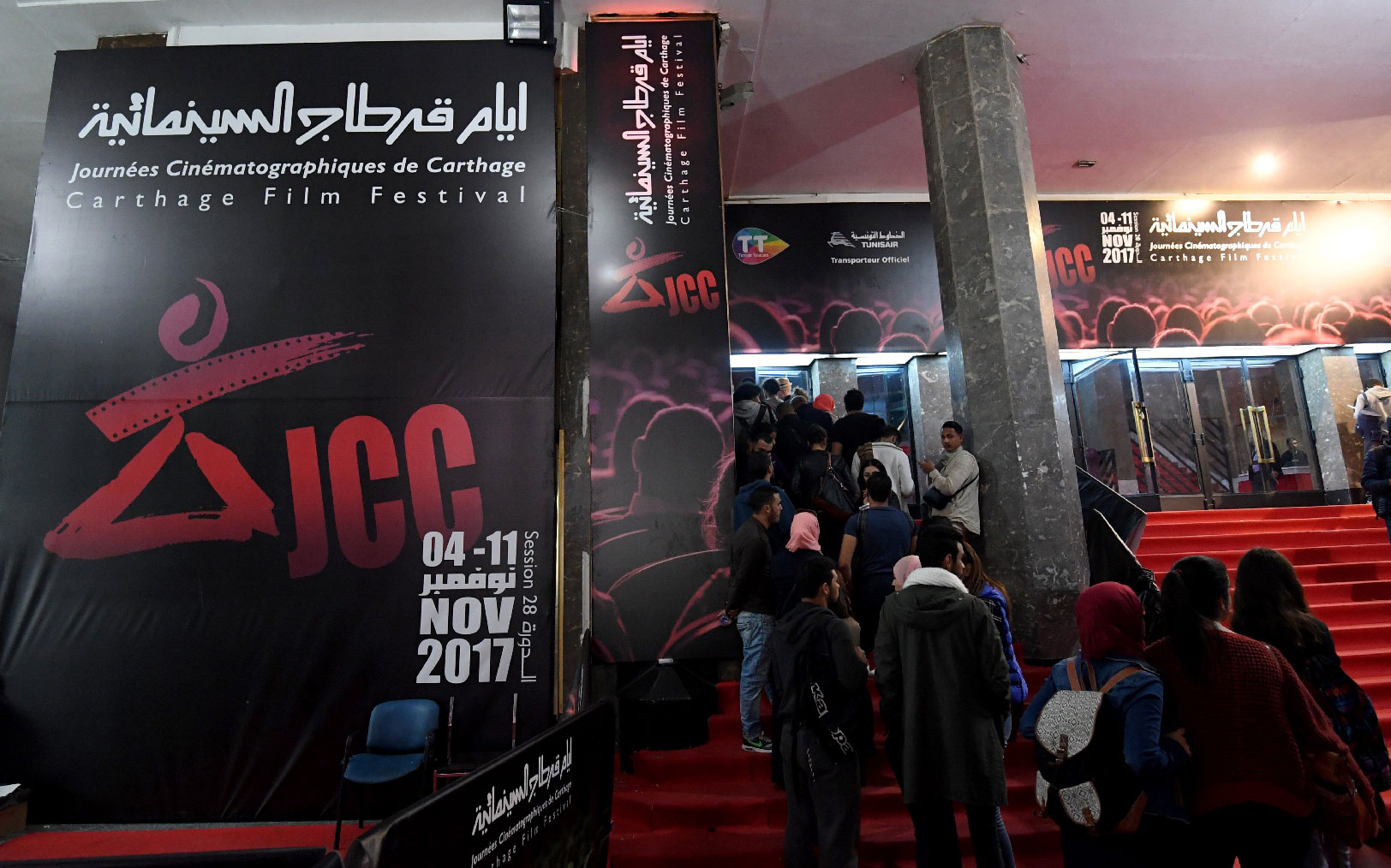 Tunisians standing in a queue outside a movie theatre in Tunis, during the 28th edition of the Carthage Film Festival on November 08, 2017.