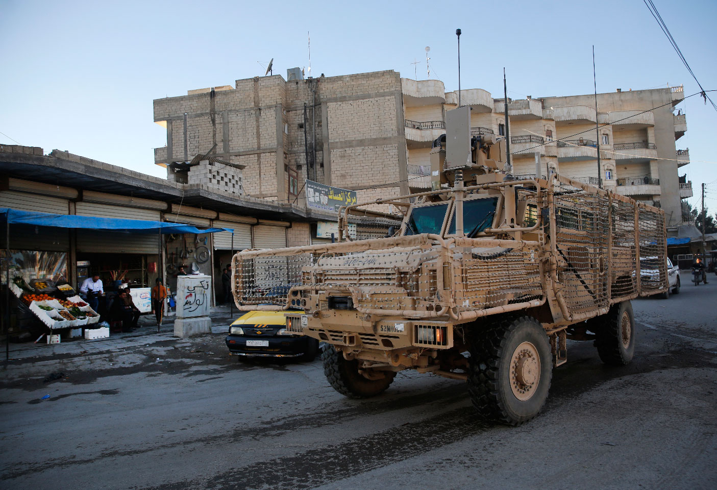 A vehicle of US troops passing on a street, in Manbij town, north Syria on March 31, 2018.