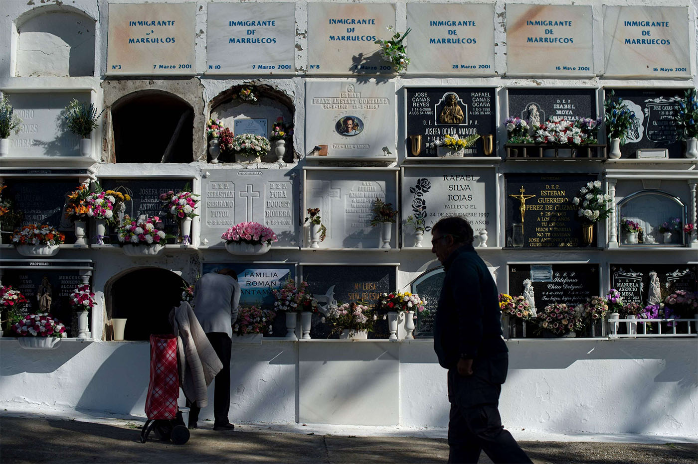 Rows of tombstones at Tarifa's cemetery mark where unnamed migrants are buried