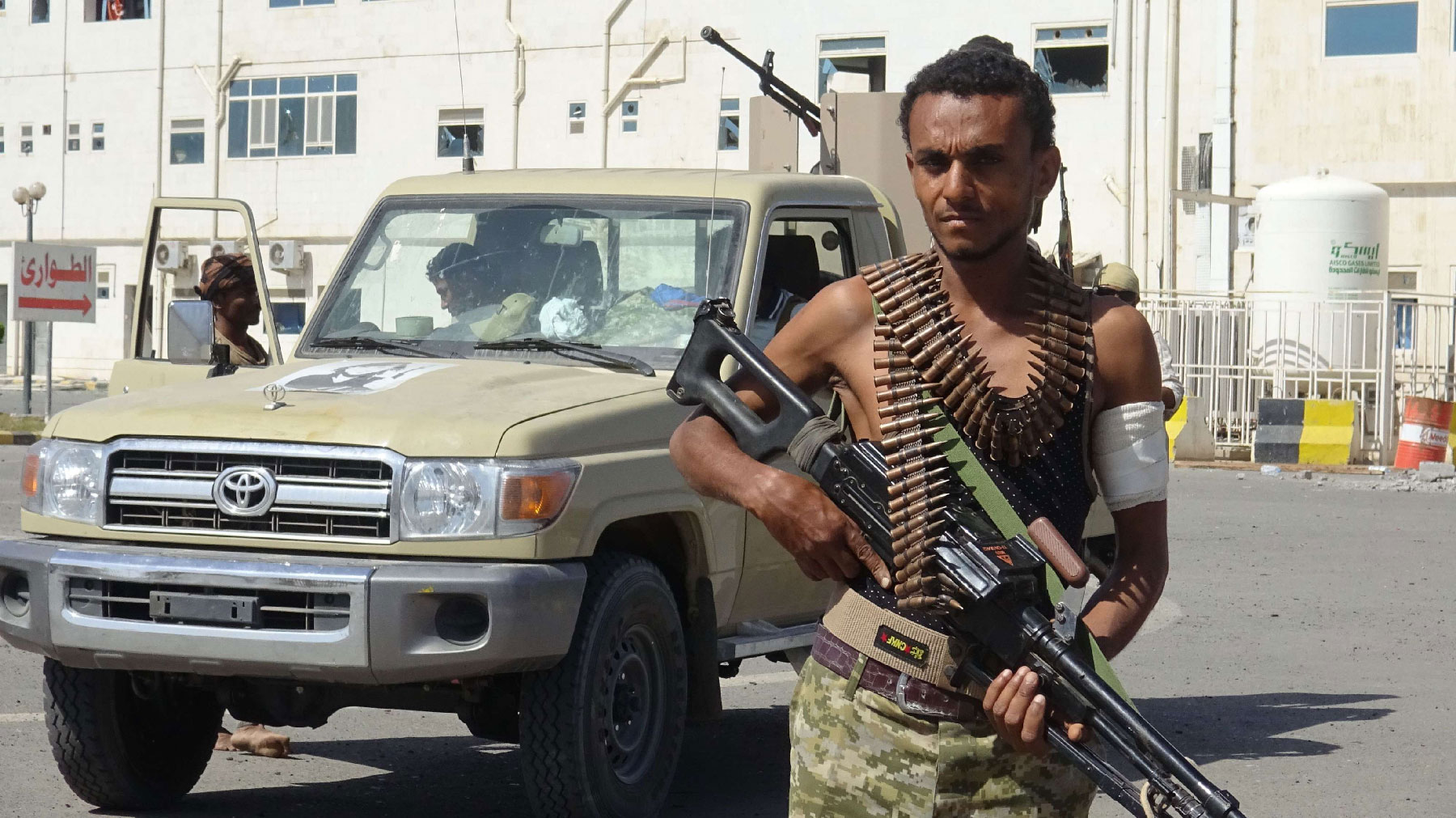 A member of the Yemeni pro-government forces is pictured in front of the May 22 Hospital on the eastern outskirts of port city of Hodeida on November 15, 2018.