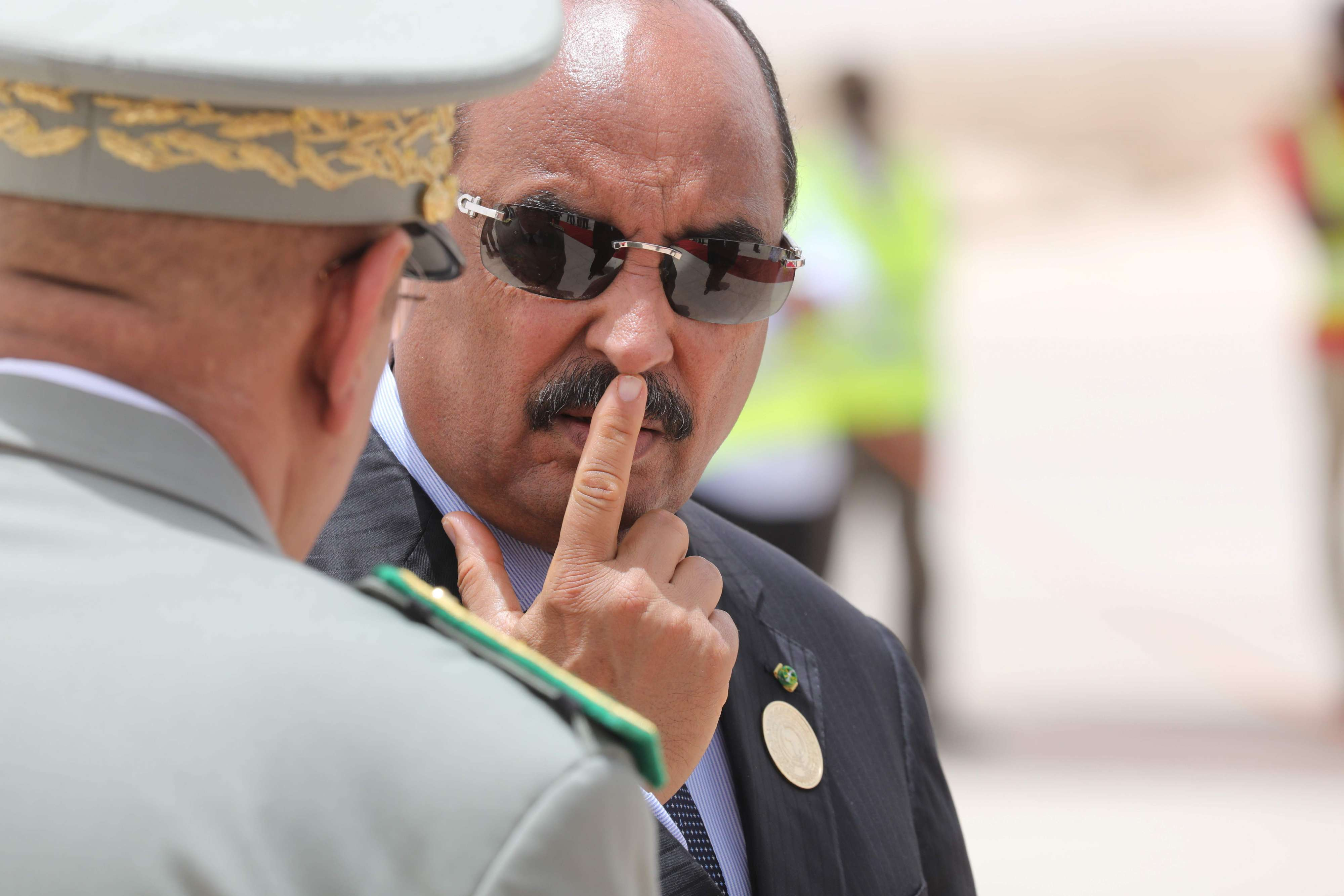 Mauritanian President Mohamed Ould Abdel Aziz waits for the arrival of the French President at Nouakchott airport on July 2, 2018.