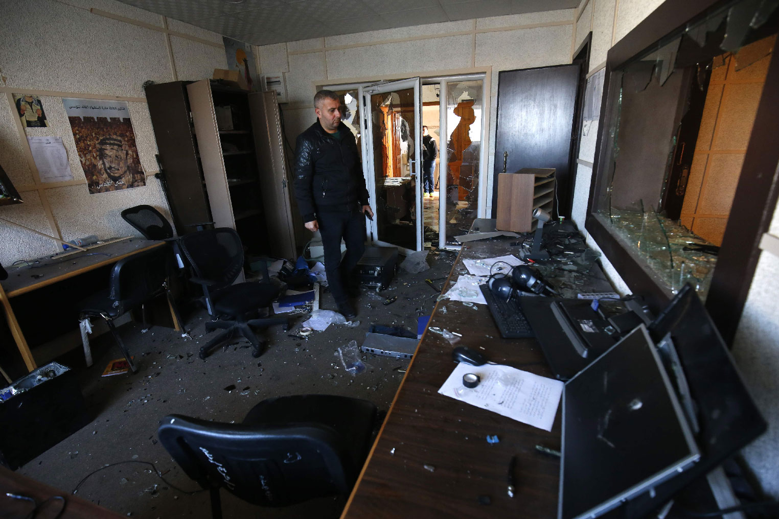 An employee of the Palestinian government-run radio and television stations inspects the damage at one of the studios on January 4, 2019, after armed men reportedly raided the building in Gaza City.