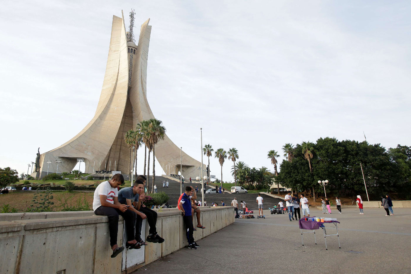 Youths sit near the Martyrs' Memorial in Algiers, Algeria September 10, 2018.
