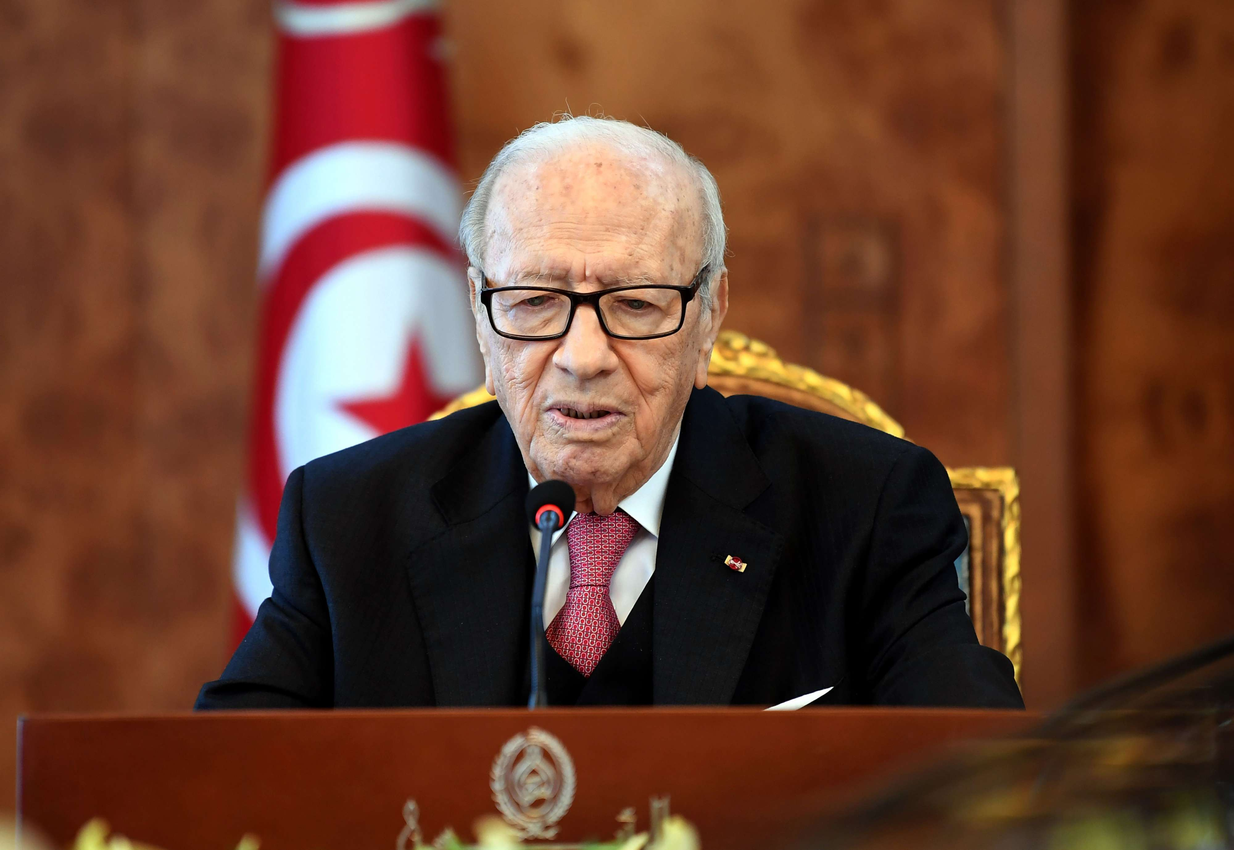 Tunisian President Beji Caid Essebsi attends a meeting with political parties, unions and employers on January 13, 2018 in Tunis, following unrest triggered by austerity measures.