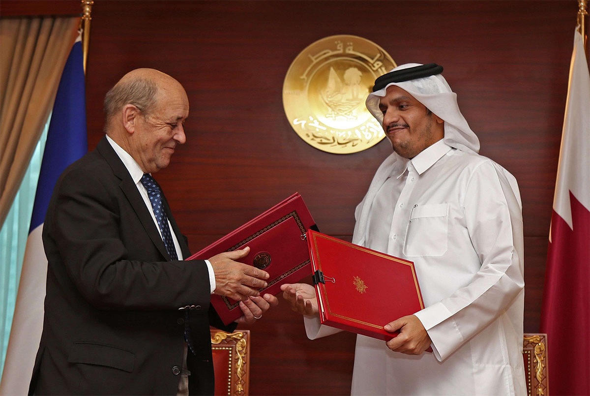 Qatari FM exchanges signed agreements with his French counterpart