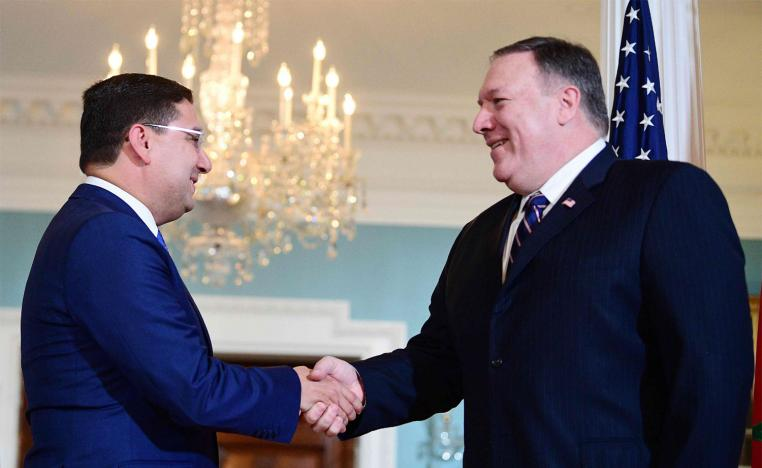 Moroccan Foreign Minister Nasser Bourita (L) shakes hands with US Secretary of State Mike Pompeo at the US State Department in Washington