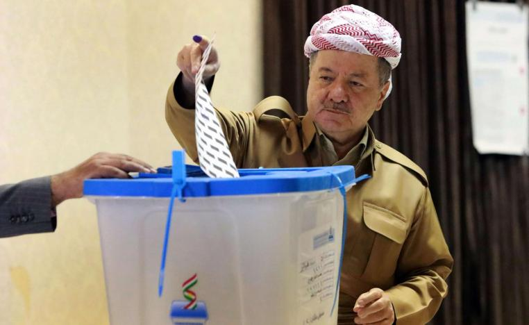 Former leader of the Iraqi Kurdish Regional Government (IKRG) Masoud Barzani gestures after casting his ballot for the parliamentary election at a polling station in Arbil, the capital of the Kurdish autonomous region in northern Iraq