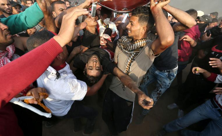 A wounded Palestinian is evacuated during a protest calling for lifting the Israeli blockade on Gaza.