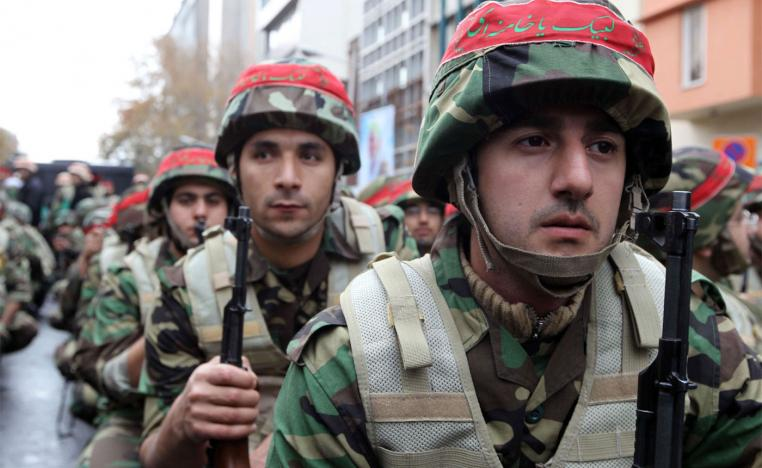 Members of Iran's paramilitary Basij militia parade in front of the former US embassy in Tehran, to mark the national Basij week