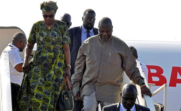South Sudan rebel leader Riek Machar and his wife Angelina Teny disembark from the plane after arriving at Juba airport in South Sudan