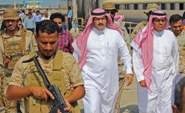 Saudi ambassador to Yemen Mohammed Said Al-Jaber (C) arrives in the southern Yemeni port of Aden to oversee an aid delivery of fuel from Saudi Arabia on October 29, 2018.