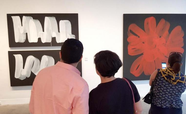 Visitors look at paintings at L'Atelier 21 gallery in Casablanca