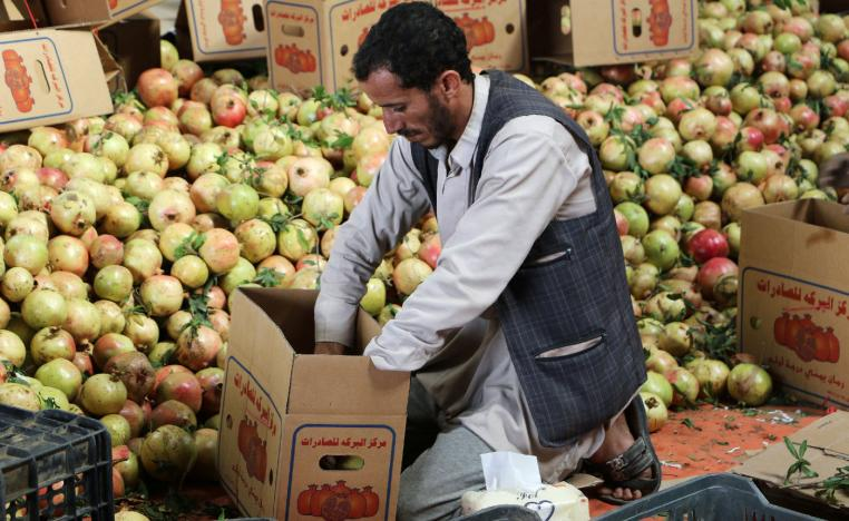 A worker packs pomegranates for export in Saada, Yemen September 25, 2018.