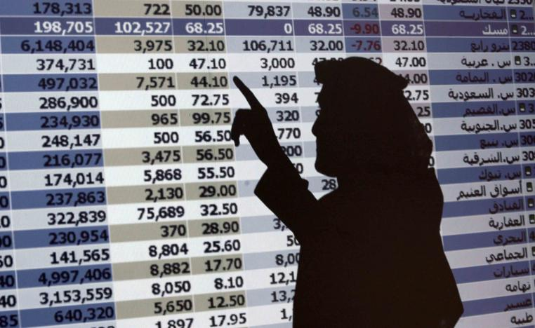 In this Oct. 7, 2008 file photo, the shadow of a Saudi trader is seen on a stock market monitor in Riyadh, Saudi Arabia