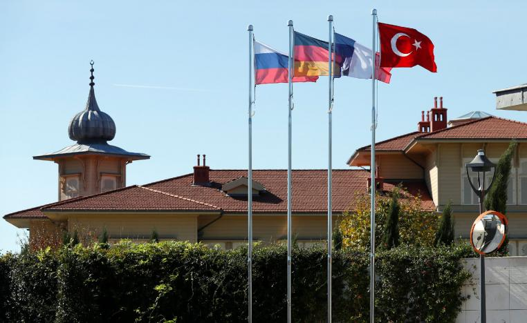 Flags of Russia, Germany, France and Turkey flutter in front of the presidential Vahdettin Mansion prior to a summit on Syria, in Istanbul, Turkey October 27, 2018.